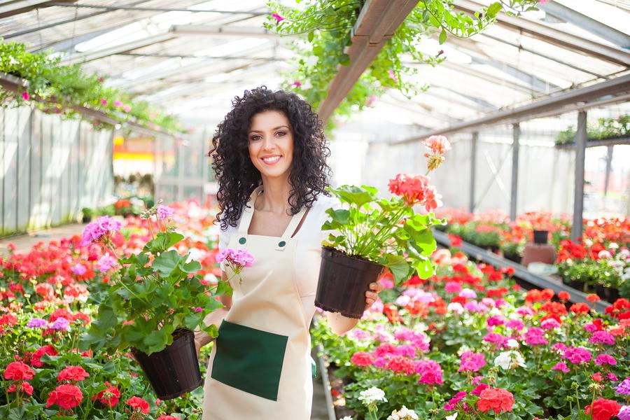 bigstock-Beautiful-woman-holding-flower-48907853